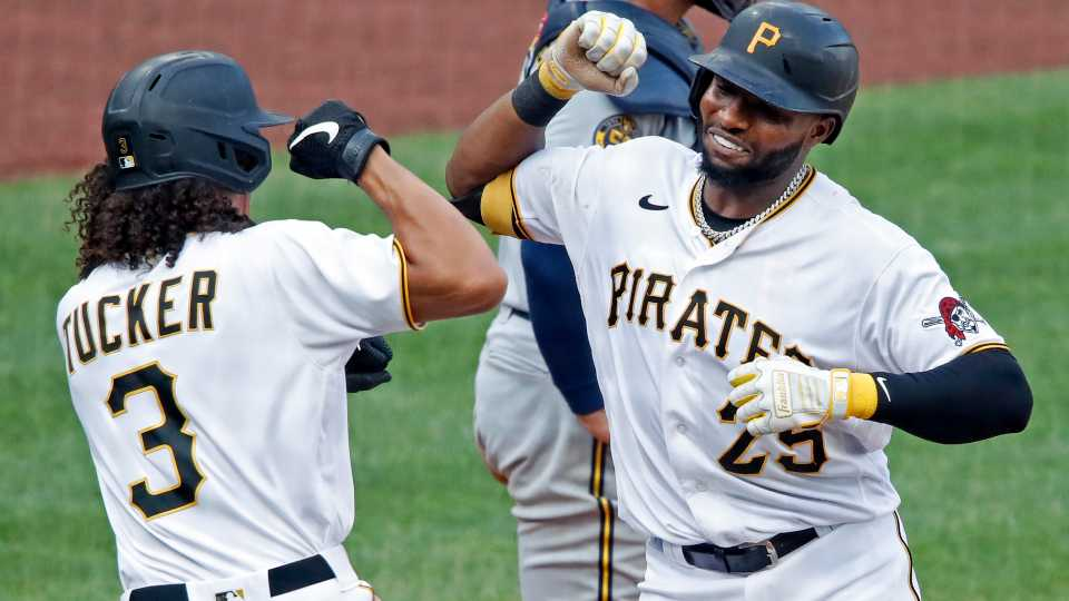 Pittsburgh Pirates' Gregory Polanco (25) celebrates with Cole Tucker after hitting a two-run home run off Milwaukee Brewers relief pitcher David Phelps during the eighth inning of a baseball game in Pittsburgh, Sunday, Aug. 23, 2020. The Pirates won 5-4.
