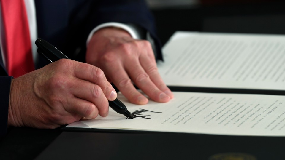 resident Donald Trump signs an executive order