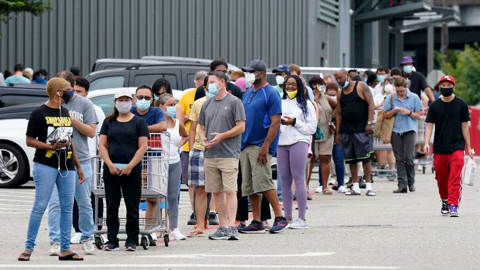 residents wait outside of Costco before storm