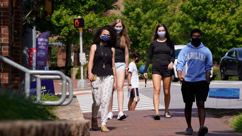 Students wear masks on campus at the University of North Carolina in Chapel Hill, N.C.
