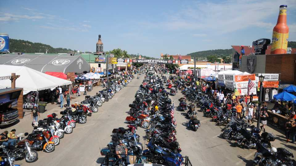 In this Aug. 5, 2015, file photo, motorcycles stretch down Main Street in Sturgis, S.D., for the landmark Sturgis Motorcycle Rally.