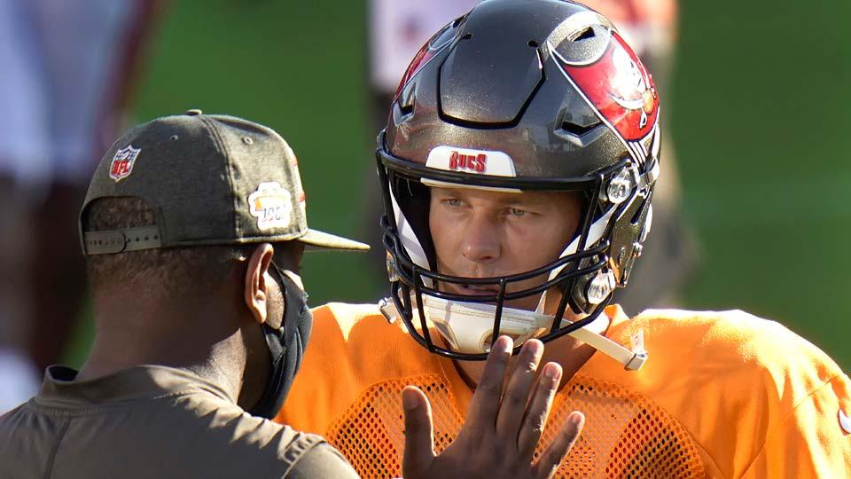 Tampa Bay Buccaneers quarterback Tom Brady talks to offensive coordinator Byron Leftwich