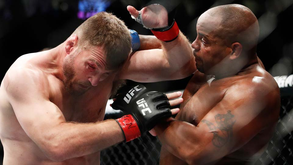 Daniel Cormier, right, fights Stipe Miocic during a heavyweight title mixed martial arts bout