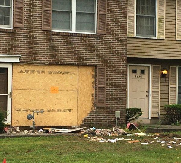 Police in Warren are looking for two people who reportedly ran from the scene after crashing into an apartment Tuesday night.