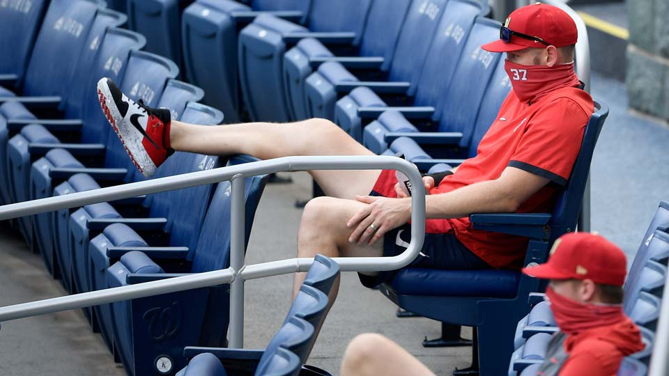 Washington Nationals' Stephen Strasburg (37) watches from the stands