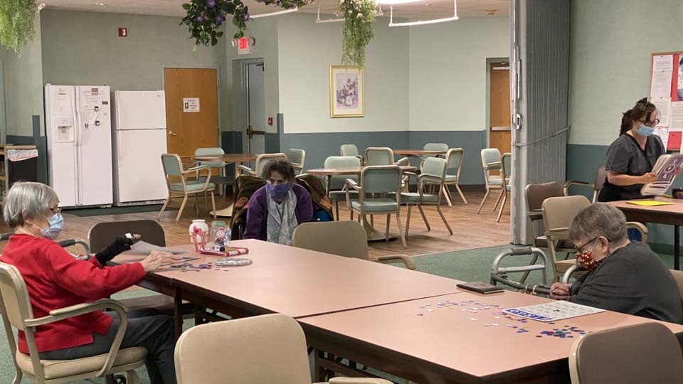 People at the Sisters of Antonine Adult Daycare play bingo on the first day back since Ohio adult daycare facilities closed March 23.