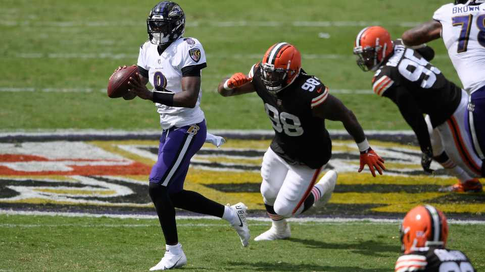 Baltimore Ravens quarterback Lamar Jackson (8) looks to pass as he is pursued by Cleveland Browns defensive tackle Sheldon Richardson (98), during the first half of an NFL football game, Sunday, Sept. 13, 2020, in Baltimore, MD.