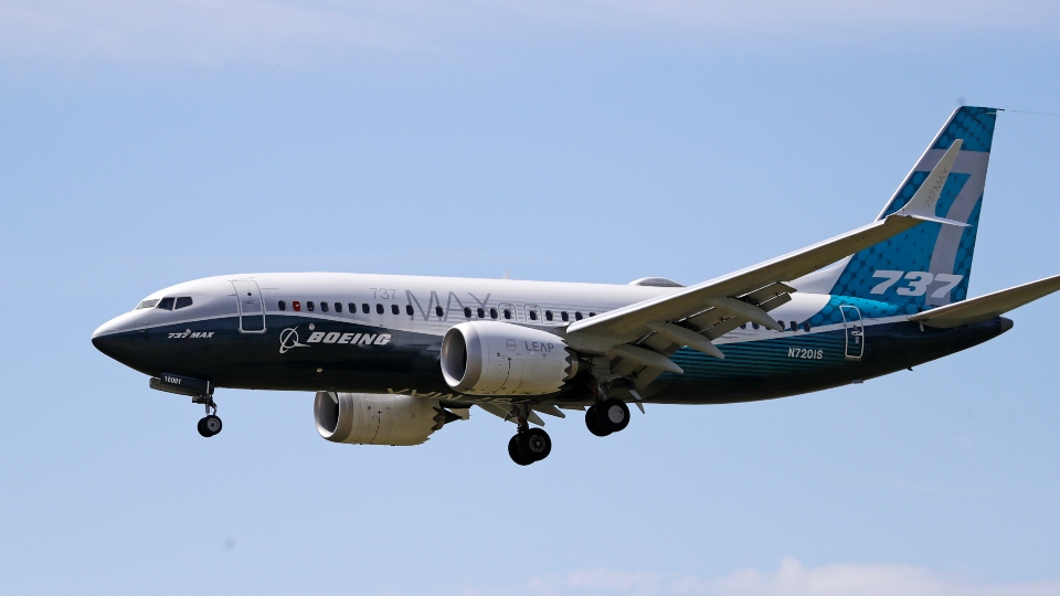 In this Monday, June 29, 2020, file photo, a Boeing 737 Max jet heads to a landing at Boeing Field following a test flight in Seattle.