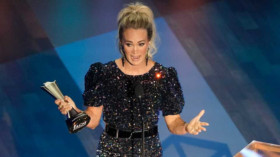 Carrie Underwood accepts the entertainer of the year award in a tie with Thomas Rhett during the 55th annual Academy of Country Music Awards at the Grand Ole Opry House on Wednesday, Sept. 16, 2020, in Nashville, Tenn.