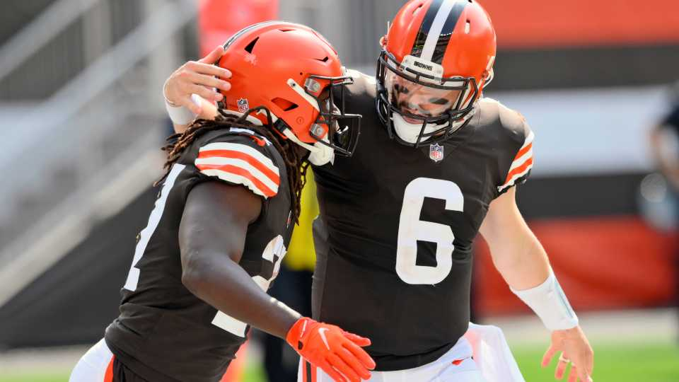 Cleveland Browns quarterback Baker Mayfield (6) congratulates running back Kareem Hunt after Hunt scored on a 9-yard touchdown pass during the first half of an NFL football game against the Washington Football Team, Sunday, Sept. 27, 2020, in Cleveland.