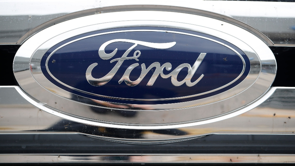 In this Oct. 20, 2019 file photograph, the company logo shines at a Ford dealership in Littleton, Colo.