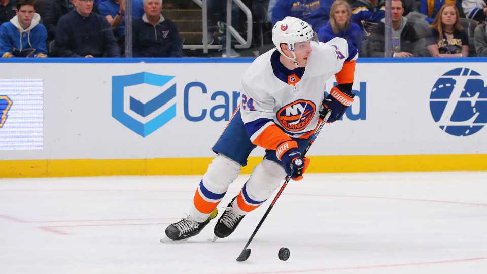 New York Islanders defenseman Scott Mayfield (24) controls the puck against the St. Louis Blues during the second period of an NHL hockey game Thursday, Feb. 27, 2020, in St. Louis.