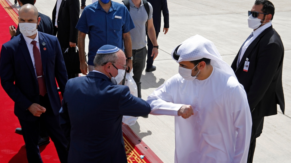 Israeli National Security Advisor Meir Ben-Shabbat, center left, elbow bumps with an Emirati official as he leaves Abu Dhabi, Arab Emirates, Tuesday, Sept. 1, 2020.