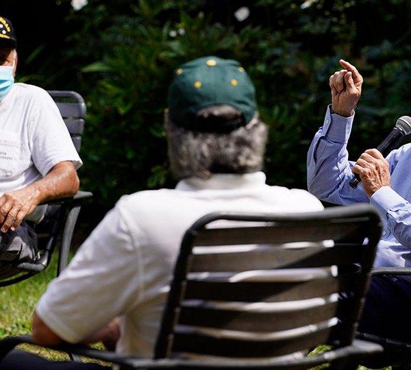 Joe Biden sitting with union members