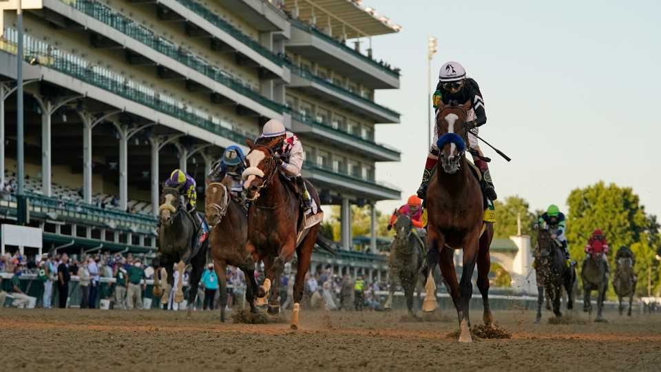 Jockey John Velazquez riding Authentic, right, crosses the finish line to win the 146th running of the Kentucky Derby at Churchill Downs, Saturday, Sept. 5, 2020, in Louisville, Ky.