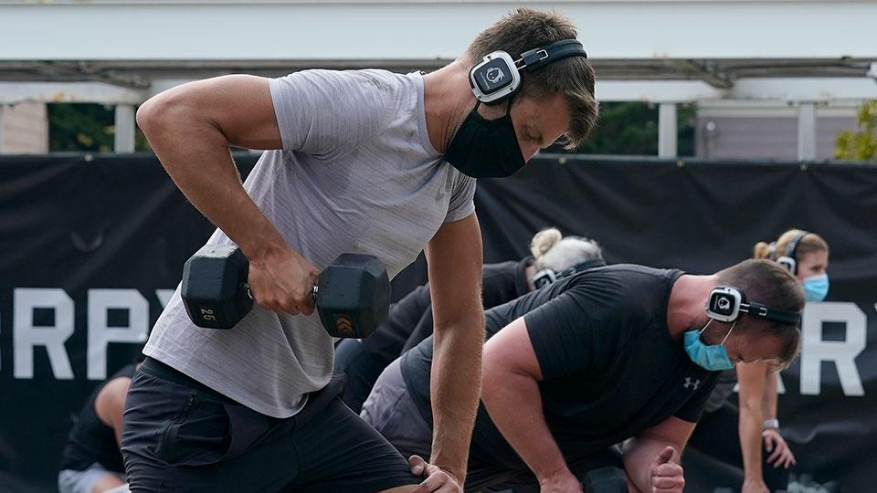 man lifting dumbbell exercising