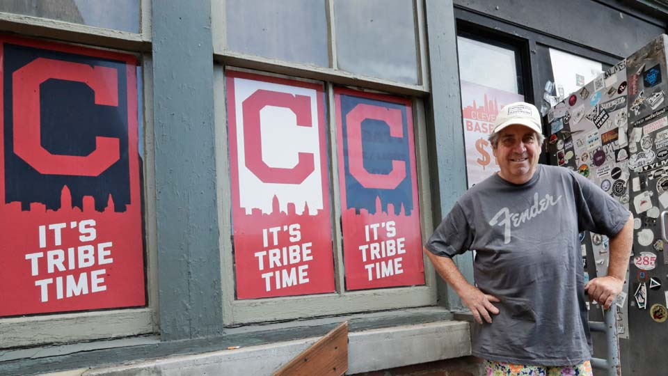Mike Miller, owner of Wilbert's Food & Music, poses in front of the restaurant before a baseball game
