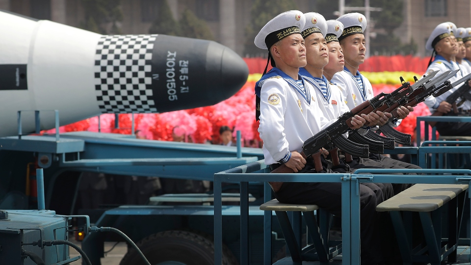 "In this April 15, 2017, file photo, navy personnel sit in front of a submarine-launched ""Pukguksong"" ballistic missile (SLBM) as it is paraded across Kim Il Sung Square in Pyongyang, North Korea."