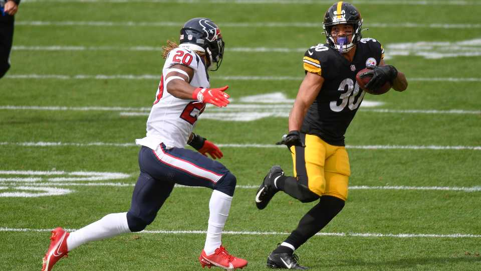Pittsburgh Steelers running back James Conner (30) tries to evade Houston Texans strong safety Justin Reid (20) after catching a pass in the first half of an NFL football game, Sunday, Sept. 27, 2020, in Pittsburgh.