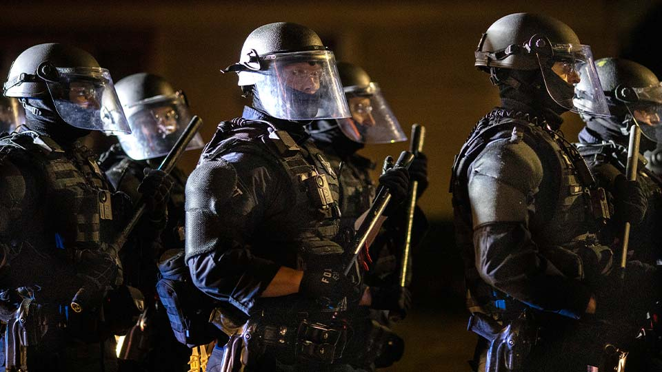 Portland police, after making arrests on the scene of the nightly protests
