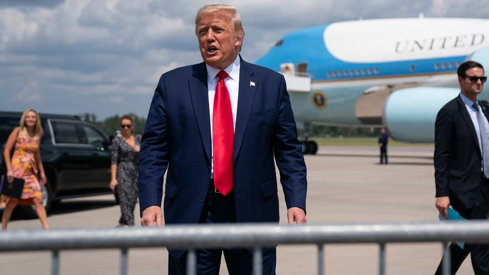 President Donald Trump talks to a crowd of supporters after arriving at Wilmington International Airport, Wednesday, Sept. 2, 2020, in Wilmington, N.C.