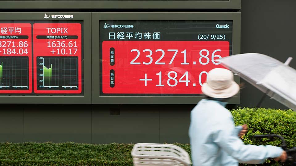 screens showing stocks Tokyo, Japan