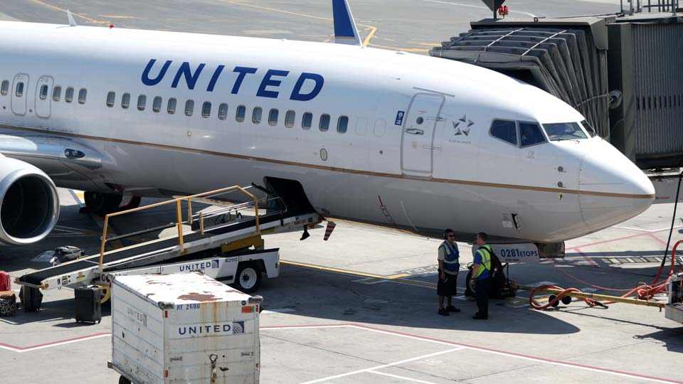 United Airlines commercial jet sits at a gate at Terminal C of Newark Liberty International Airport in Newark, N.J.