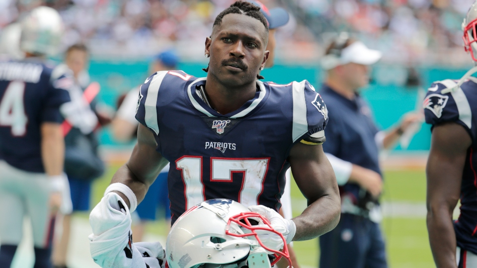 In this Sunday, Sept. 15, 2019, file photo, New England Patriots wide receiver Antonio Brown stands on the sidelines during the first half at an NFL football game against the Miami Dolphins in Miami Gardens, Fla.
