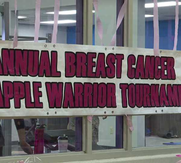 Breast Cancer Apple Warrior Tournament sign
