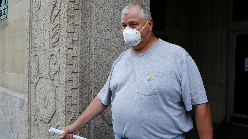 This July 21, 2020 file photo shows former Ohio House Speaker Larry Householder leaving the federal courthouse after an initial hearing following charges against him and four others alleging a $60 million bribery scheme, in Columbus, Ohio.