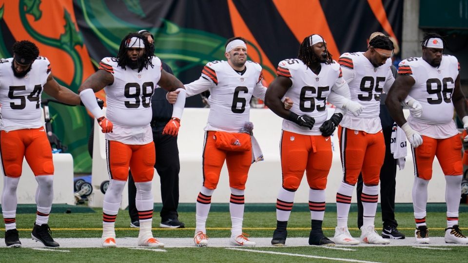 Cleveland Browns quarterback Baker Mayfield (6) locks arms with teammates during the national anthem before an NFL football game against the Cincinnati Bengals, Sunday, Oct. 25, 2020, in Cincinnati.