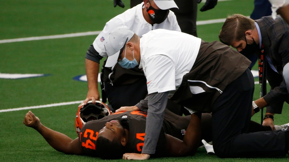 Cleveland Browns running back Nick Chubb (24) receives assistance from team staff after suffering an unknown injury in the first half of an NFL football game against the Dallas Cowboys in Arlington, Texas, Sunday, Oct. 4, 2020.