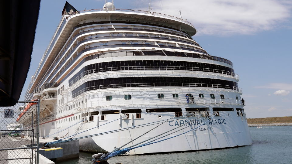n this Saturday, April 4, 2020, file photo, Carnival cruise line ship Carnival Magic is docked at Port Canaveral, in Cape Canaveral, Fla.