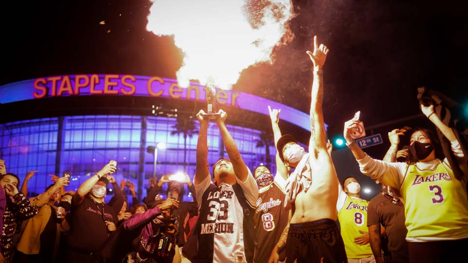 Los Angeles Lakers fans celebrate outside of Staples Center, Sunday, Oct. 11, 2020