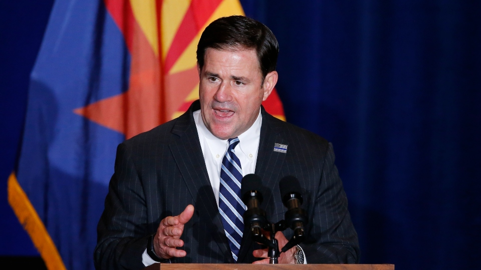 "In this Tuesday, Aug. 11, 2020, file photo, Republican Arizona Gov. Doug Ducey speaks prior to Vice President Mike Pence speaking at the ""Latter-Day Saints for Trump"" Coalition launch event in Mesa, Ariz."