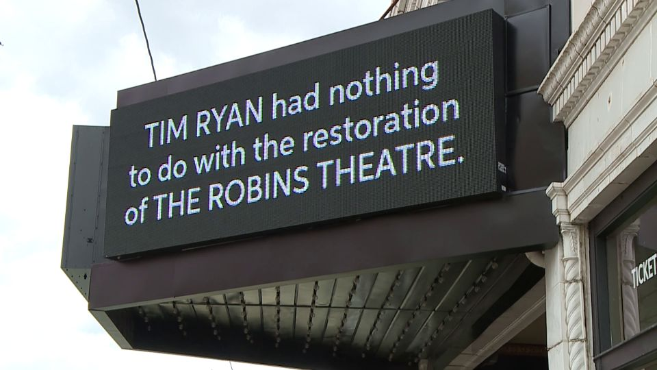 A sign on the Robins Theatre marquee in Warren is getting a lot of attention.