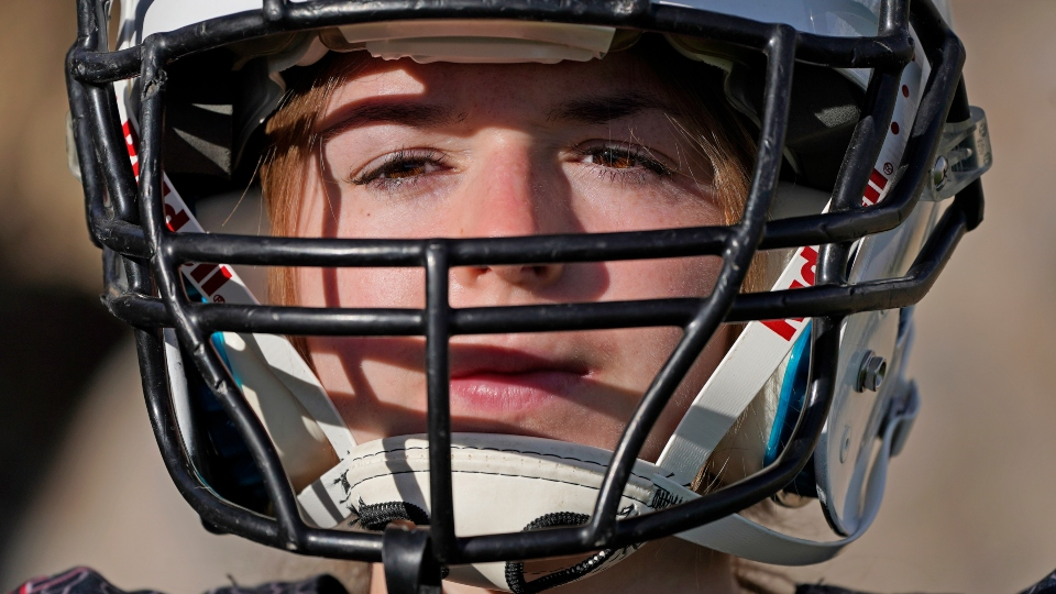 Sam Gordon poses for a photograph, Oct. 20, 2020, in Herriman, Utah. Gordon was the only girl in a tackle football league when she started playing the game at age 9.