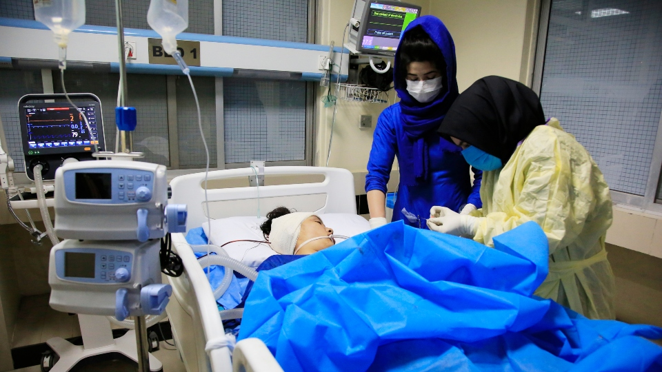 An Afghan receives treatment at hospital after suicide attack in Kabul, Afghanistan, Saturday, Oct. 24, 2020.