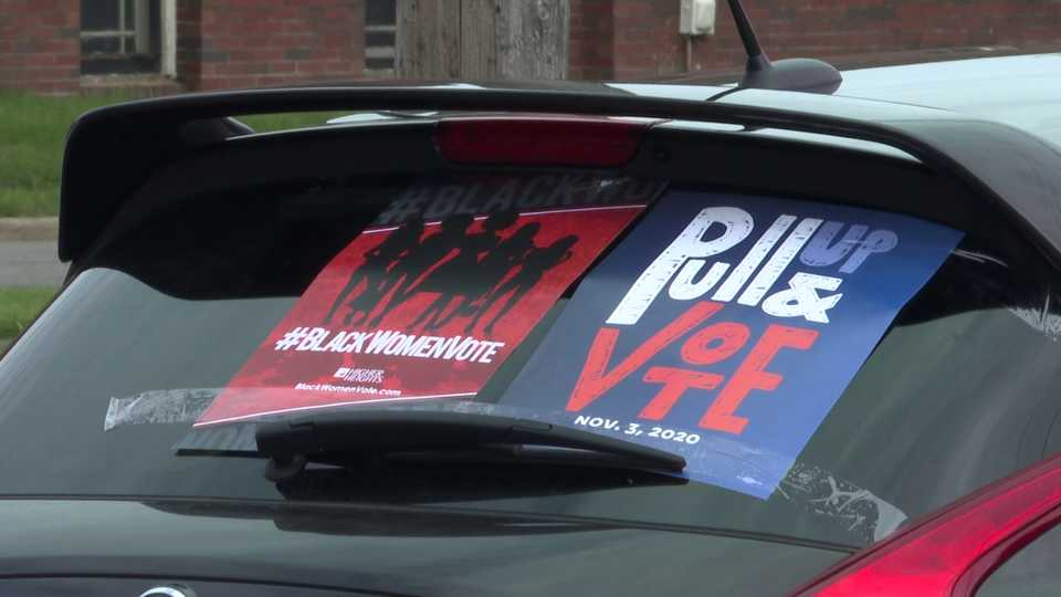 Voting signs on car
