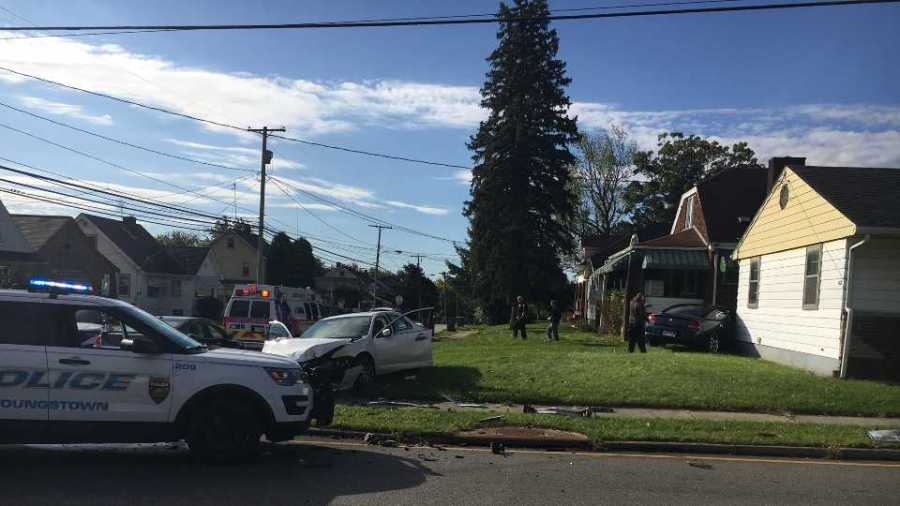 A two-vehicle crash in Youngstown caused a car to hit a house.