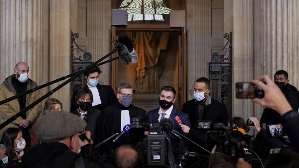 Alek Skarlatos, center right, Anthony Sadler, right, Mark Moogalian, left, and their lawyer Thibault de Montbrial, center left, deliver a speech during the Thalys attack trial at the Paris courthouse, Friday, Nov. 20, 2020