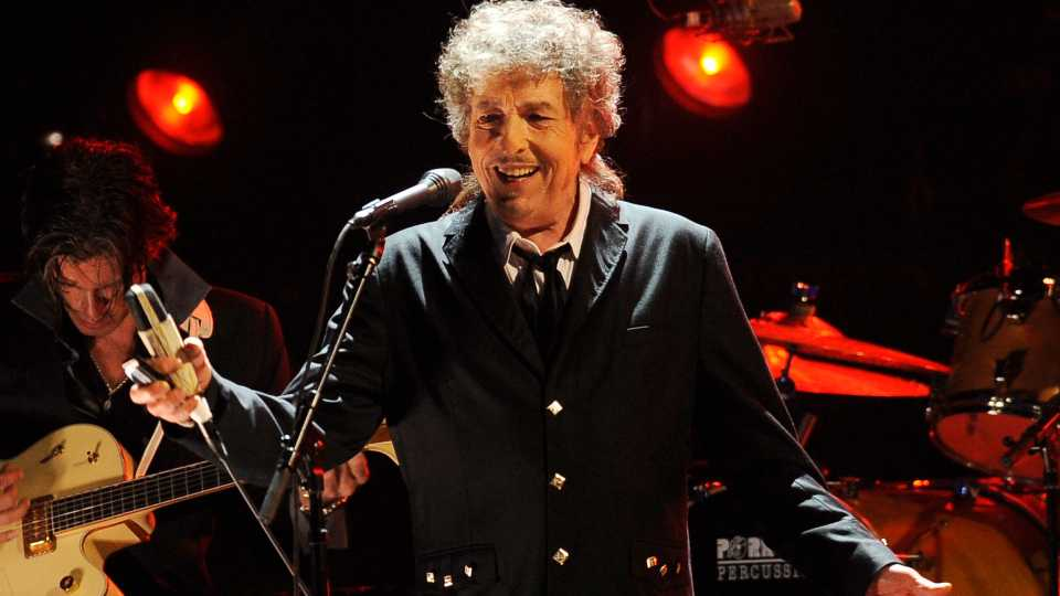 """Musician Bob Dylan performs in Los Angeles on Jan. 12, 2012. Transcripts of lost 1971 Dylan interviews with the late American blues artist Tony Glover and letters the two exchanged reveal that Dylan changed his name from Robert Zimmerman because he worried about anti-Semitism, and that he wrote """"Lay Lady Lay"""" for actress Barbra Streisand. The items are among a trove of Dylan archives being auctioned in November 2020 by Boston-based R.R. Auction."""