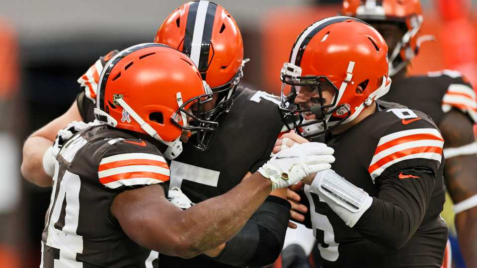 Cleveland Browns quarterback Baker Mayfield, right, congratulates running back Nick Chubb, left, after Chubb rushed for a 9-yard touchdown during the second half of an NFL football game against the Houston Texans, Sunday, Nov. 15, 2020, in Cleveland.