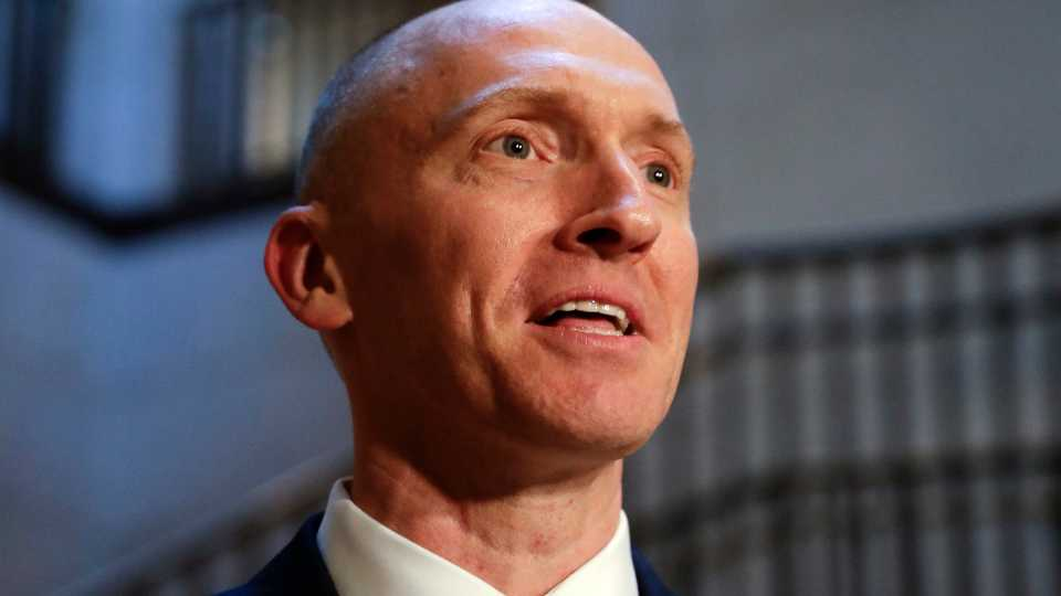 """In this Nov. 2, 2017, photo, Carter Page, a foreign policy adviser to Donald Trump's 2016 presidential campaign, speaks with reporters following a day of questions from the House Intelligence Committee, on Capitol Hill in Washington. Page, who was the target of a secret surveillance warrant during the FBI's Russia investigation says in a federal lawsuit filed Friday, Nov. 27, 2020, that he was the victim of """"unlawful spying."""" The suit from Carter Page alleges a series of omissions and errors made by FBI and Justice Department officials in applications they submitted to the Foreign Intelligence Surveillance Court to eavesdrop on Page on suspicion that he was an agent of Russia."""