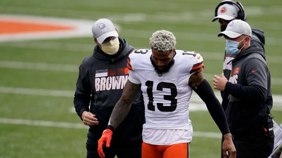 Cleveland Browns' Odell Beckham Jr. (13) leaves the field after being injured during the first half of an NFL football game against the Cincinnati Bengals, Sunday, Oct. 25, 2020, in Cincinnati. Browns star wide receiver Odell Beckham Jr. will miss the rest of the season after tearing a knee ligament during Sunday's 37-34 win at Cincinnati.