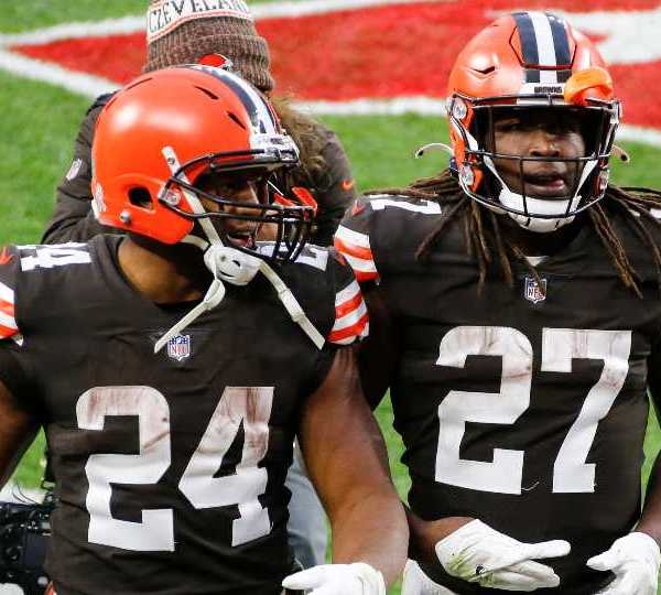 Cleveland Browns running backs Nick Chubb (24) and Kareem Hunt (27) walk off the field after an NFL football game, Sunday, Nov. 15, 2020, in Cleveland. Cleveland's dynamic duo of backs combined for 230 yards and helped the Browns (6-3) chew up the final five minutes in a 10-7 win over the Texana.