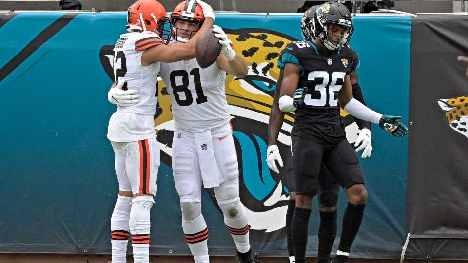 Cleveland Browns tight end Austin Hooper (81) celebrates his touchdown catch with wide receiver KhaDarel Hodge, left, as Jacksonville Jaguars cornerback Luq Barcoo (36) walks away dejected during the first half of an NFL football game, Sunday, Nov. 29, 2020, in Jacksonville, Fla.