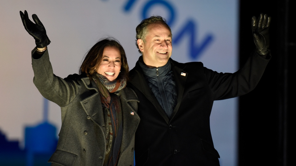 Democratic vice presidential candidate Sen. Kamala Harris, D-Calif., and her husband Doug Emhoff take the stage during a drive-in get out the vote rally, Monday, Nov. 2, 2020, in Philadelphia.