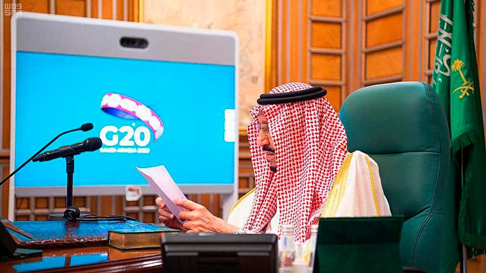 FILE - In this March 26, 2020, file photo released by Saudi Press Agency, SPA, Saudi King Salman, chairs a video call of world leaders from the Group of 20 and other international bodies and organizations, from his office in Riyadh, Saudi Arabia. The Nov. 21-22, 2020, Group of 20 summit, hosted by Saudi Arabia, will be held online this year because of the coronavirus. The pandemic has offered the G-20 an opportunity to prove how such bodies can facilitate international cooperation in crises — but has also underscored their shortcomings.