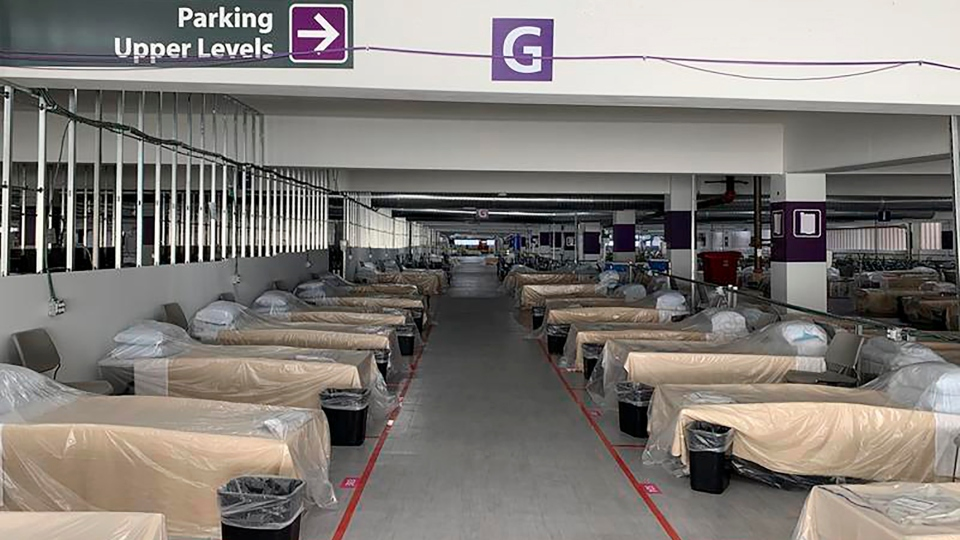 FILE - Hospital beds sit inside Renown Regional Medical Center's parking garage, which has been transformed into an alternative care site for COVID-19 patients in Reno, Nev., on Wednesday, Nov. 11, 2020. Faulting inaction in Washington, governors and state lawmakers are racing to get needed pandemic relief to small businesses, the unemployed, renters and others affected by the widening coronavirus outbreak. In some cases, they are figuring out how to spend the last of a federal relief package passed in the spring as an end-of-year deadline approaches and the current COVID-19 surge threatens their economies once again.